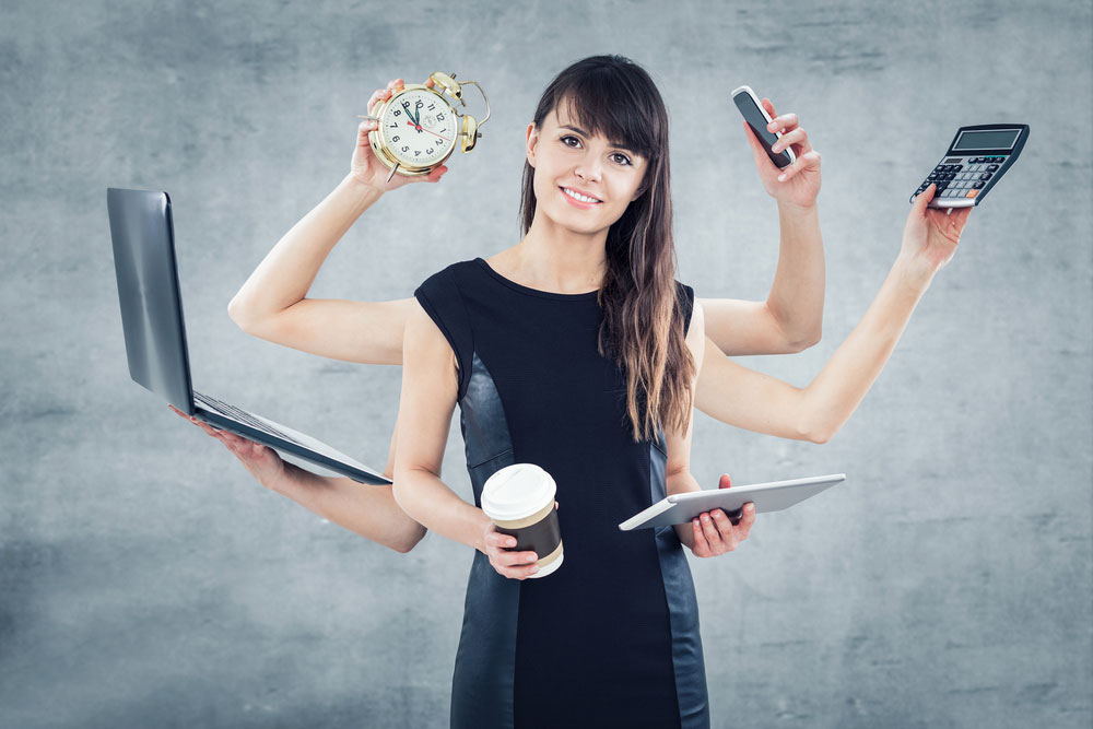 woman managing time and coffee and calls and computer