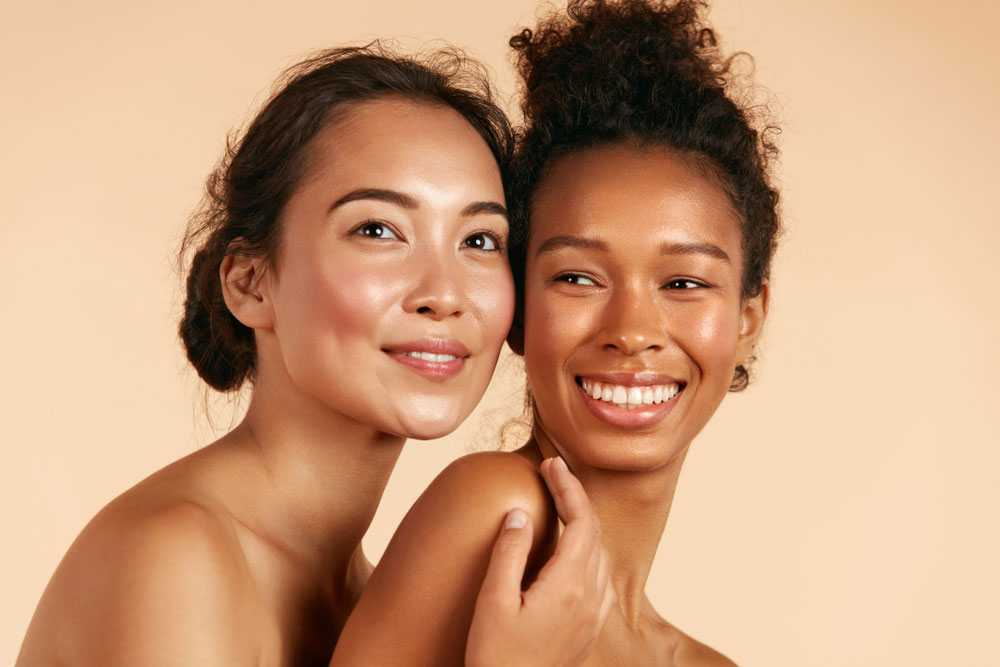 two women hugging feeling healthy and hydrated
