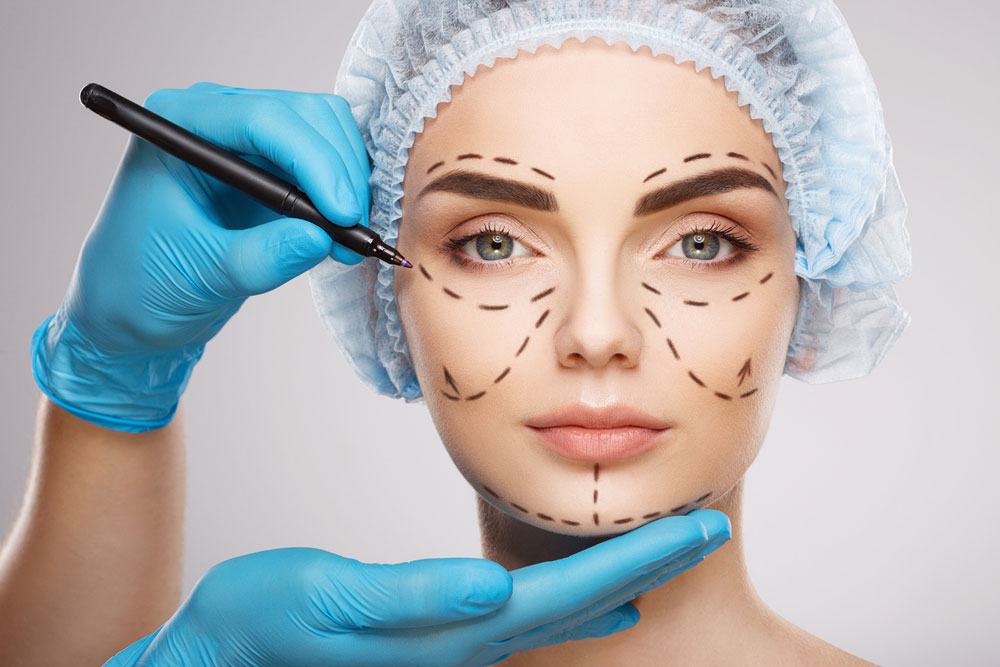 woman getting outlines drawn on her face to look younger