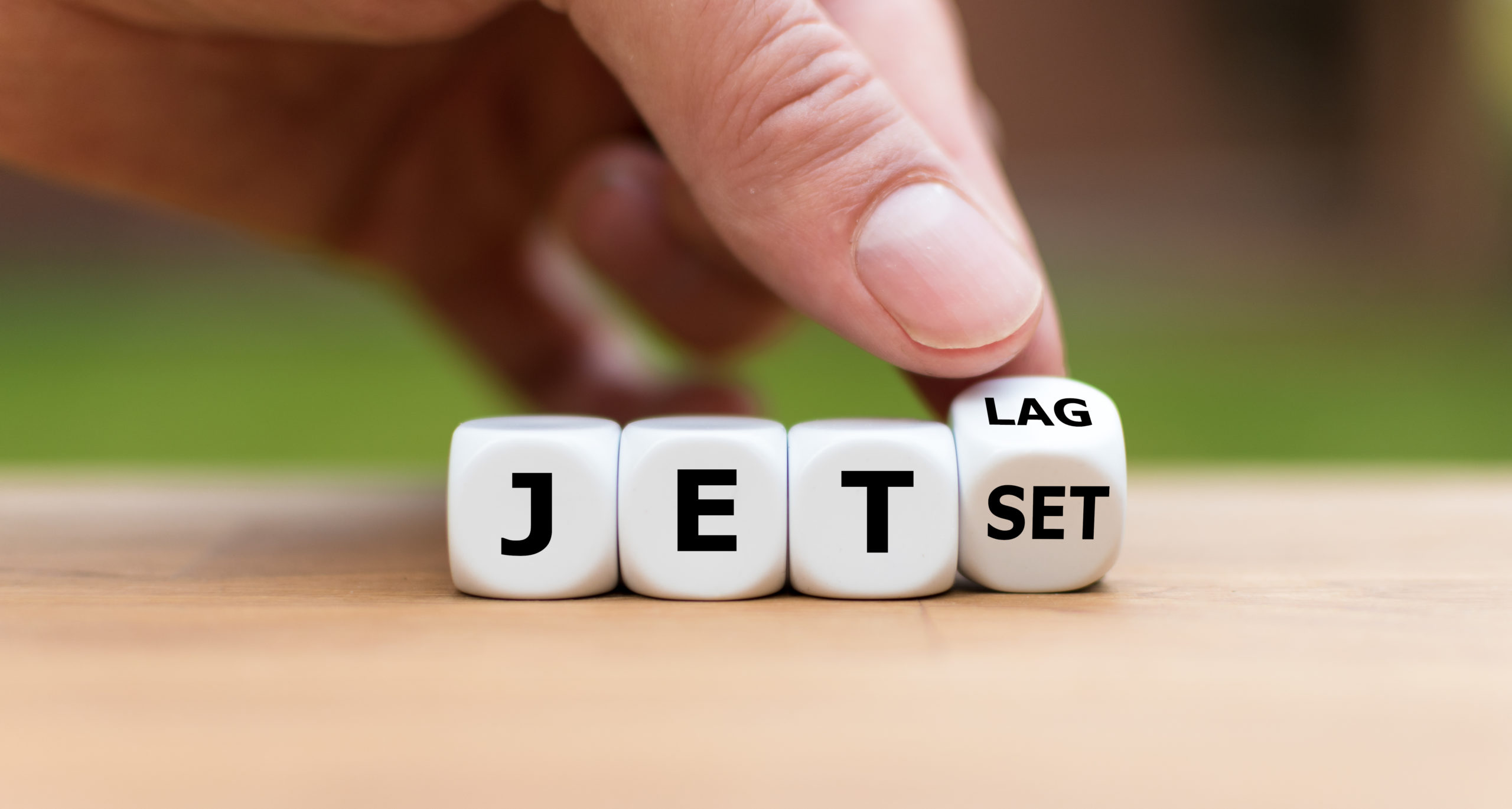 dice spelling out jet lag