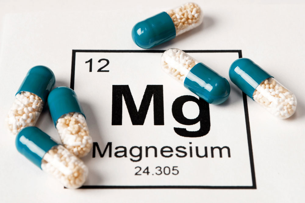 magnesium pills over the element sign