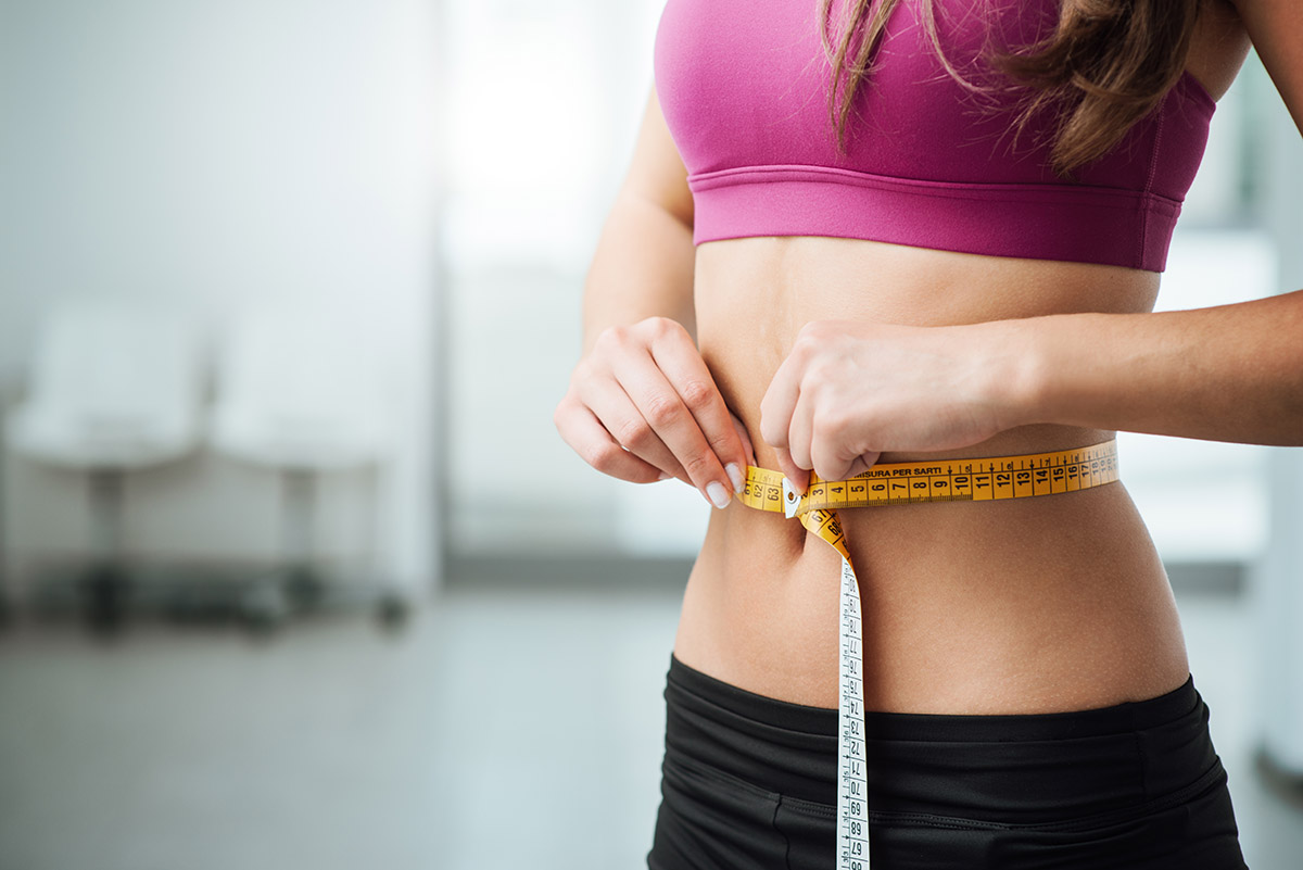 iv therapy benefits for weight loss. woman measuring her waist