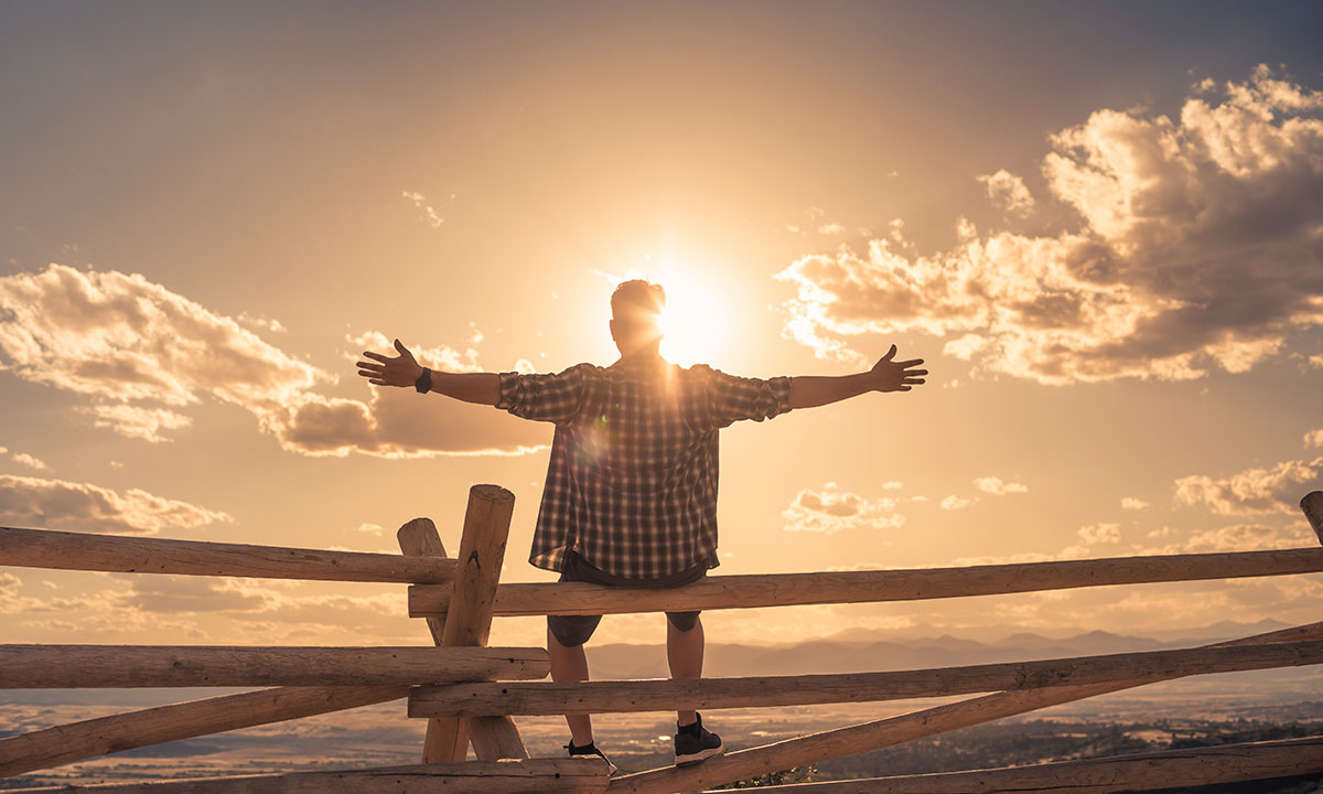man feeling energized at sunrise from injectable vitamins