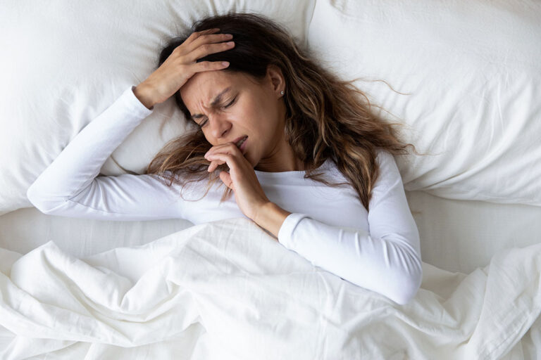 girl with hangover seeking iv therapy for hangover relief